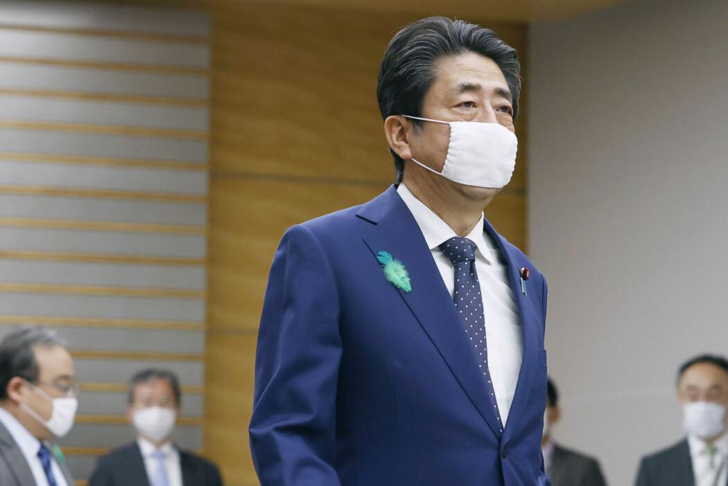 Den japanske statsministeren Shinzo Abe med munnbind. Bruken av ansiktsmasker i Japan og Kina startet med spanskesyken, men bruken fortsatte etter at utbruddet var over.